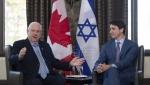 Predsednik Izraela poklonio kanadskom premijeru čarape s motivom Jerusalima